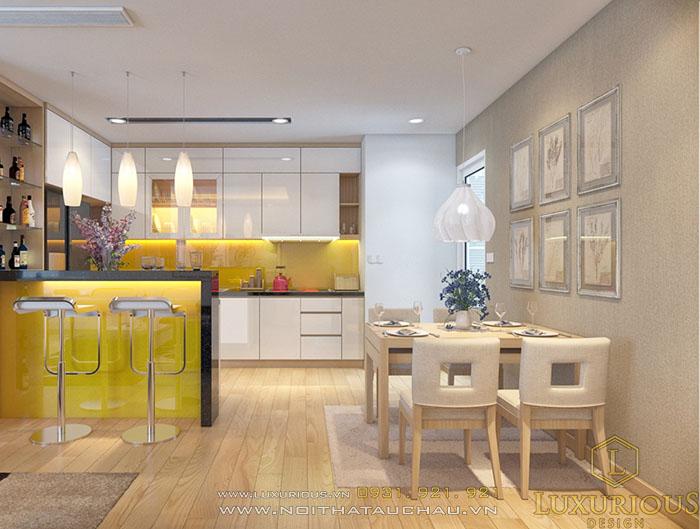 đảo bếp kết hợp bàn ăn cho căn hộ chung cư màu vàng