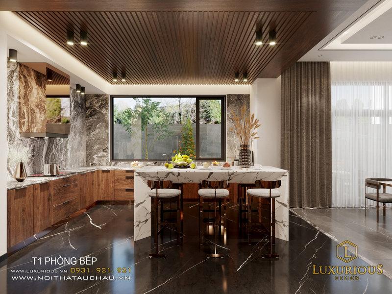 Một đảo bếp bằng đá trắng nổi bật trong không gian nấu nướng