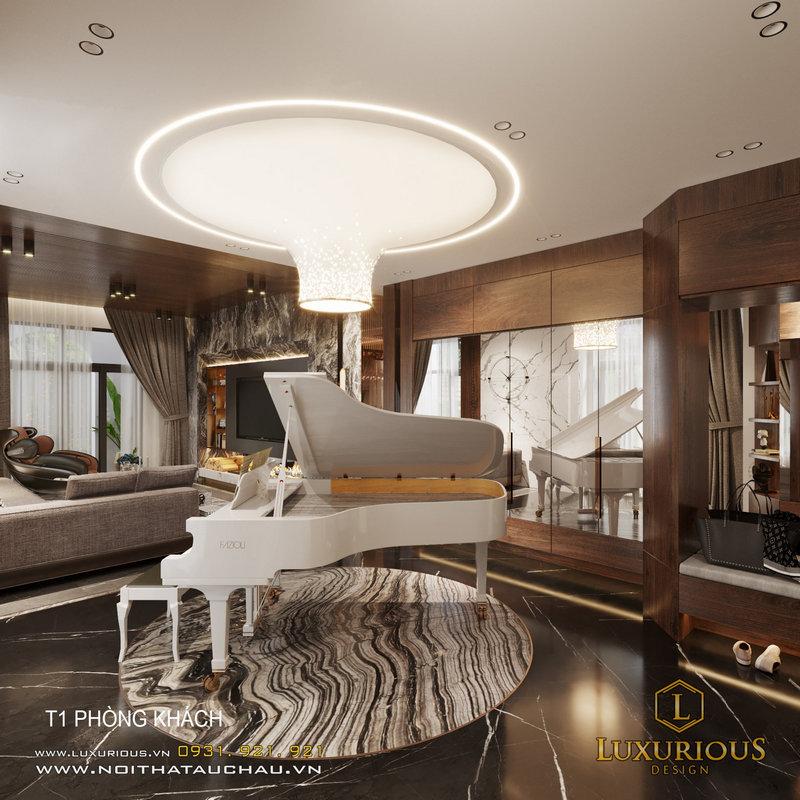 Chiếc đàn Piano được đặt trên một tấm thảm tròn và được làm nổi bật bởi một chiếc đèn trần